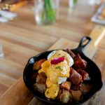 brisket & valbella pork sausage hash with 2 poached eggs & hollandaise