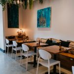 Cozy brunch restaurant interiors featuring artwork from local artists