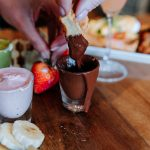 Dipping into a dark chocolate fondue