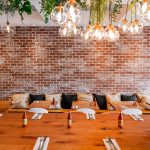 amily friendly Dining hall at Monki Bistro Inglewood with hanging plants and communal seating