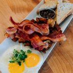 Morning after breakfast in Calgary with fried eggs, crispy thick cut bacon and toast